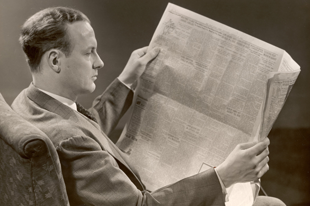 A Man Reads A Newspaper